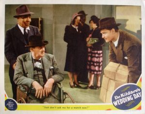 Dr. Kildare's Wedding Day lobby card - the hilarious scene where Red is trying to juggle 5 packages in a phone booth