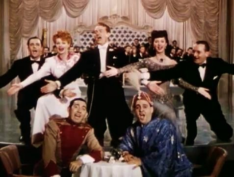 Colorized photo from Du Barry Was a Lady, featuring the entire cast - Gene Kelly, Lucille Ball, Red Skelton, Virginia Mayo, Rags Ragland, Zero Mostel