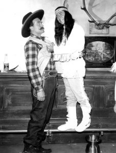 "Photo of Red Skelton and singer Bobby Darin in a skit from the television program The Red Skelton Show. Skelton plays his ""Deadeye"" character while Darin plays someone who takes issue with him."