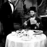 Photo of Red Skelton as Freddie the Freeloader. Maurice Marsac, as the waiter, has just brought Freddie the bill for his fine meal at a posh restaurant on The Red Skelton Show.