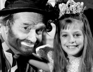Closeup photo of Red Skelton as Freddie the Freeloader with young actress Linda Sue Risk from The Red Skelton Show.