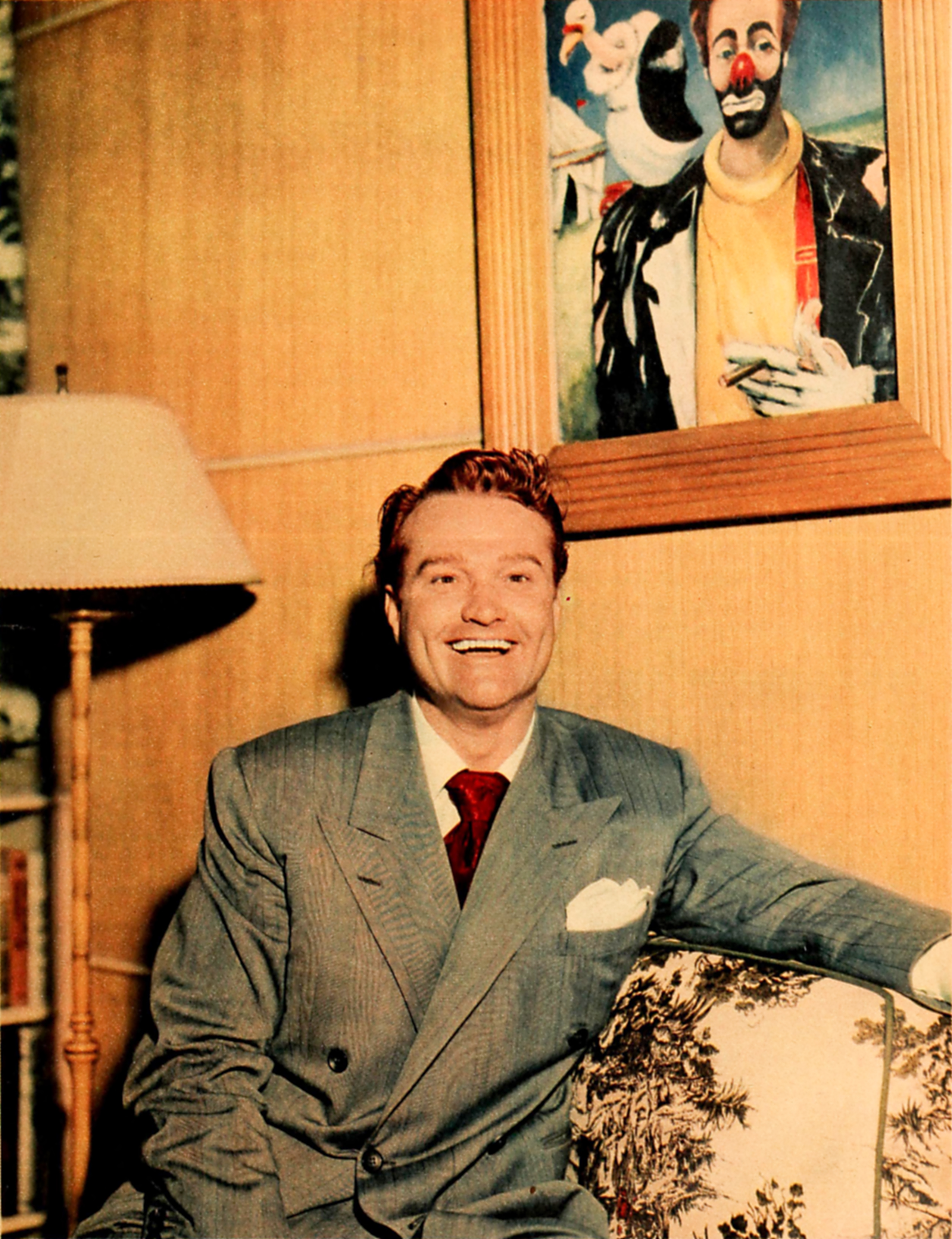 Red Skelton at home with his artwork, 1948