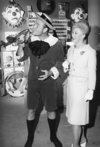 """Publicity photo from The Red Skelton Hour. Pictured are Skelton as """"The Mean Widdle Kid"""" or """"Junior"""" and Ginger Rogers as Mrs. Cavendish."""