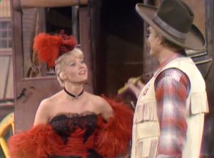 Pat Priest, fresh off the stagecoach, talking to Sheriff Deadeye (Red Skelton) in Our Man Fink