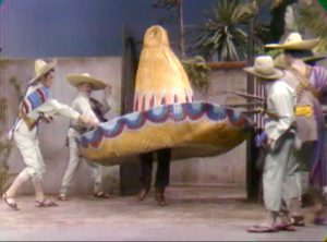 Sheriff Deadeye tries to escape Pancho Vanilla's hideout, disguised as a giant sombrero