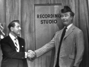 """David Rose meets Clem Kadiddlehopper at the music store in """"Cafe Paree"""" on The Red Skelton Show"""