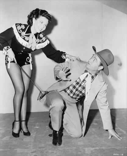 Ann Miller branding Red Skelton in a publicity photo from Texas Carnival