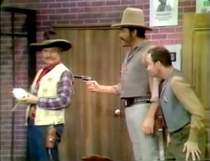"""The bank robber threatens to kill Sheriff Deadeye in """"Sheriffs are Bought Not Made"""""""