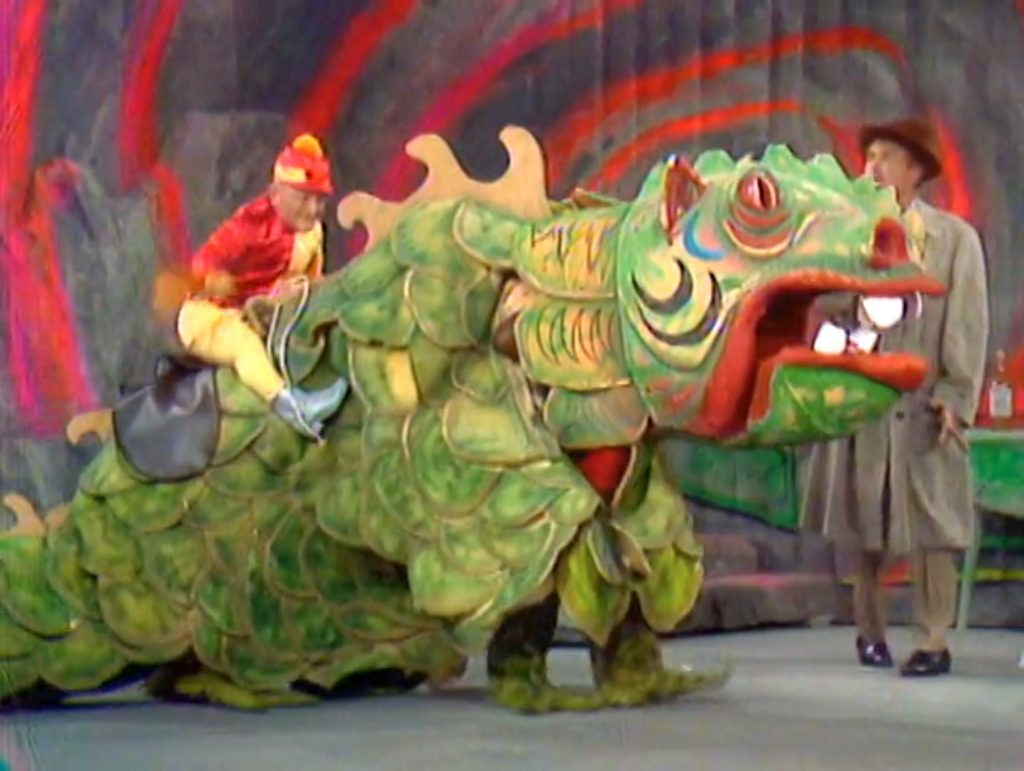 """Billy Barty riding a fire-breathing dragon! """"I don't know what the writers are drinking, but it must be good stuff!"""""""