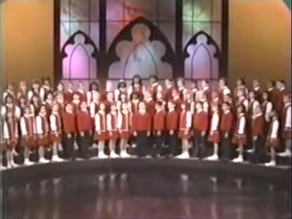 Children's Choir singing a medley of Christmas songs and hymns in The Plight Before Christmas