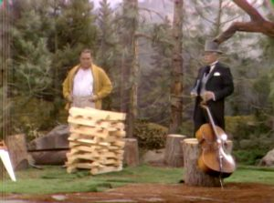 "Humphrey T. Humble demonstrates his rapid tree clearing skill to San Fernando Red at the lumber camp in ""Goodbye Mr. Gyp"""