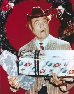 Red Skelton Wacky Pose with Gift boxes in Christmas Theme Portrait