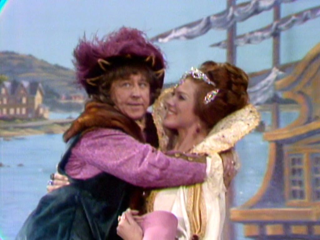 Queen Isabella (Francine York) carrying Christopher Columbus (George Gobel).