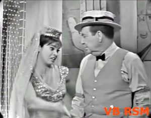 """Daisy June (Juliet Prowse) and Mr. Ringading (Phil Harris) in """"The Greatest Schmo on Earth"""""""