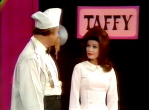 Red Skelton and Beverly Powers working at the candy factory
