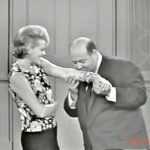 """Child psychologist (Stubby Kaye) kissing Mrs. Cavendish (Janis Paige) on her jewelry in """"Ten Little Fingers and Twelve Little Toes"""""""