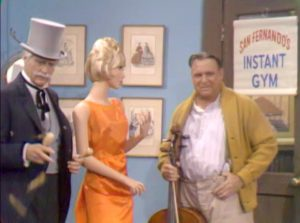 """San Fernando Red meets the gentle giant, Humphrey T. Humble, at the dress shop in """"Goodbye Mr. Gyp"""""""