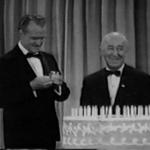 Red Skelton helping Ed Wynn celebrate his 80th birthday