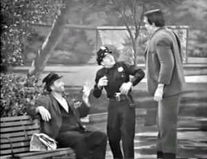Freddie the Freeloader takes advantage of his new friend, Herman Munster, to frighten a cop in the park