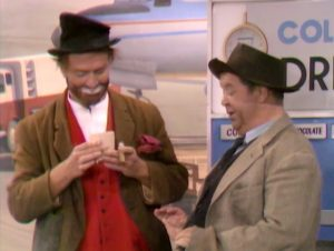 Hobos Freddie the Freeloader (Red Skelton) and Mugsy (Hal Smith) at the airport in The Sweet Smell of Failure