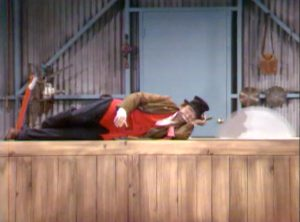 "Freddie the Freeloader (Red Skelton) sleeping on a buzz saw in ""Never on a Bum Day"""