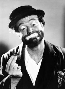Red Skelton as Freddie the Freeloader, holding a cigar