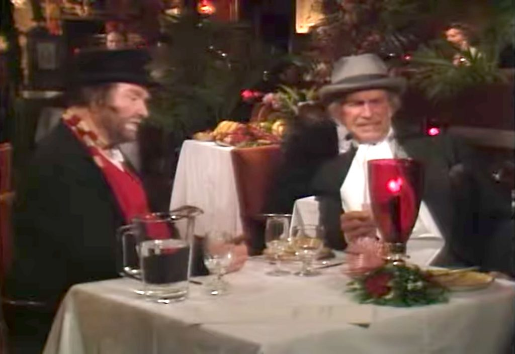 Freddie the Freeloader and The Professor try to enjoy Christmas dinner together