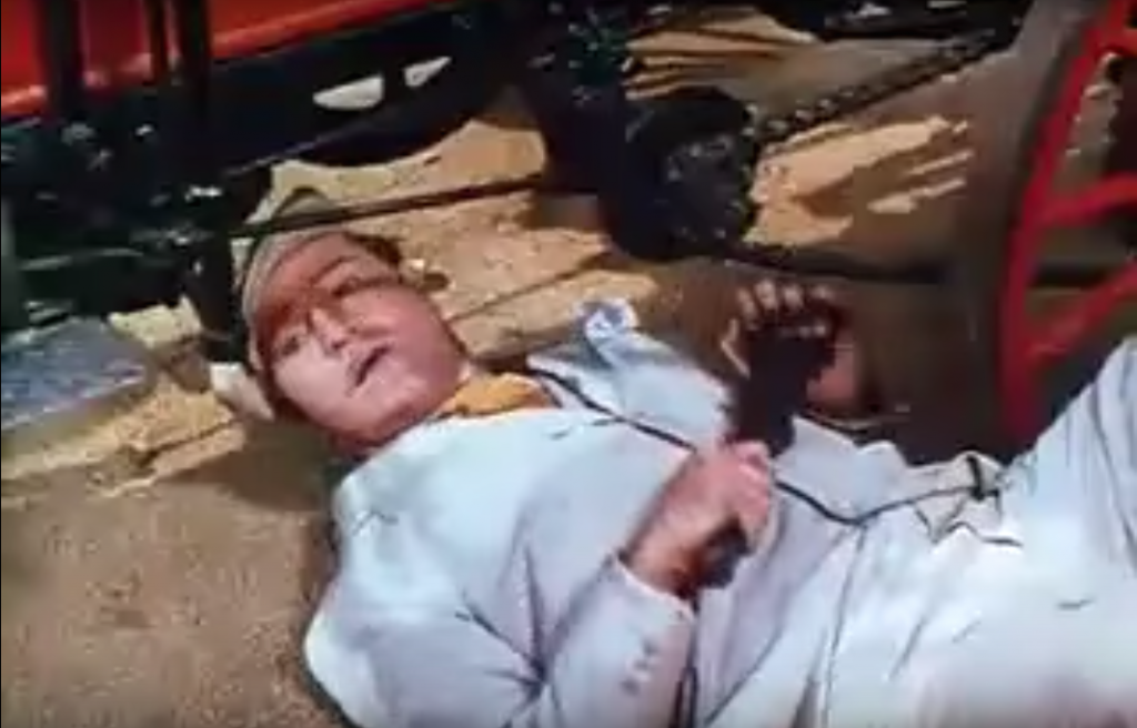 Red Skelton as struggling mechanic working on his Gasmobile