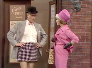 "George Appleby models one of his company's mini-skirts.  His wife Clara is not amused in ""Better Dead than Wed"""