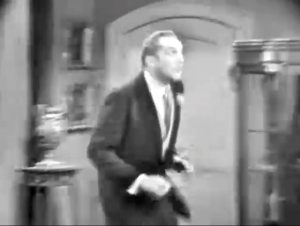 Vincent Price as art collector reacts to the hobos' discovery of the original Da Vinci