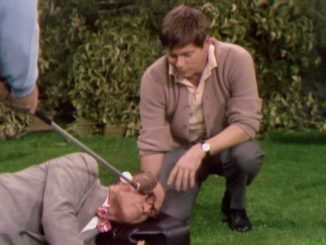 Dr. Harvey Butterfingers (Robert Morse) on the golf course with George Appleby (Red Skelton).in Somebody Down Here Hates Me