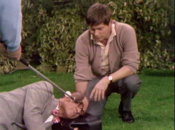 Dr. Harvey Butterfingers (Robert Morse) on the golf course with George Appleby (Red Skelton).