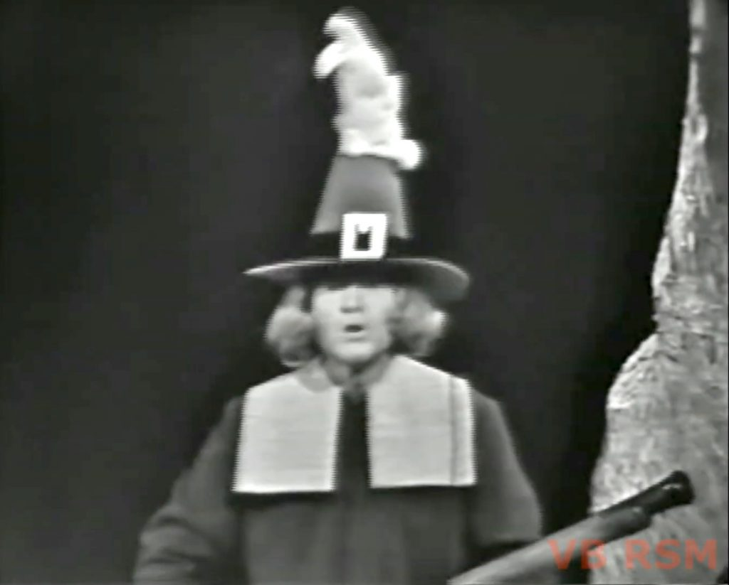Pilgrim Red with a bunny hitchhiking a ride on his hat