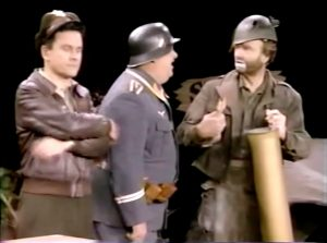"""Colonel Hogan, Sergeant Schultz, and Freddie the Freeloader depending on Freddie's survival skills in """"How You Gonna Keep 'Em Down in the Dump?"""""""