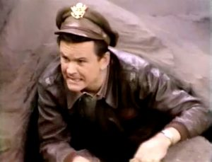 """Bob Crane as Colonel Hogan, escaping from Stalag 13 in """"How You Gonna Keep 'Em Down in the Dump"""""""