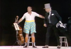 """Humphrey T. Humble (Jackie Coogan), cellist, tricked into Madison Square Garden by San Fernando Red (Red Skelton) in """"Goodbye Mr. Gyp"""""""