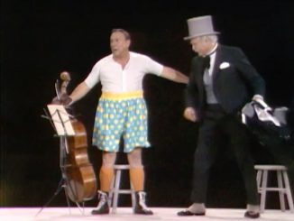 "Humphrey T. Humble (Jackie Coogan), cellist, tricked into Madison Square Garden by San Fernando Red (Red Skelton) in ""Goodbye Mr. Gyp"""