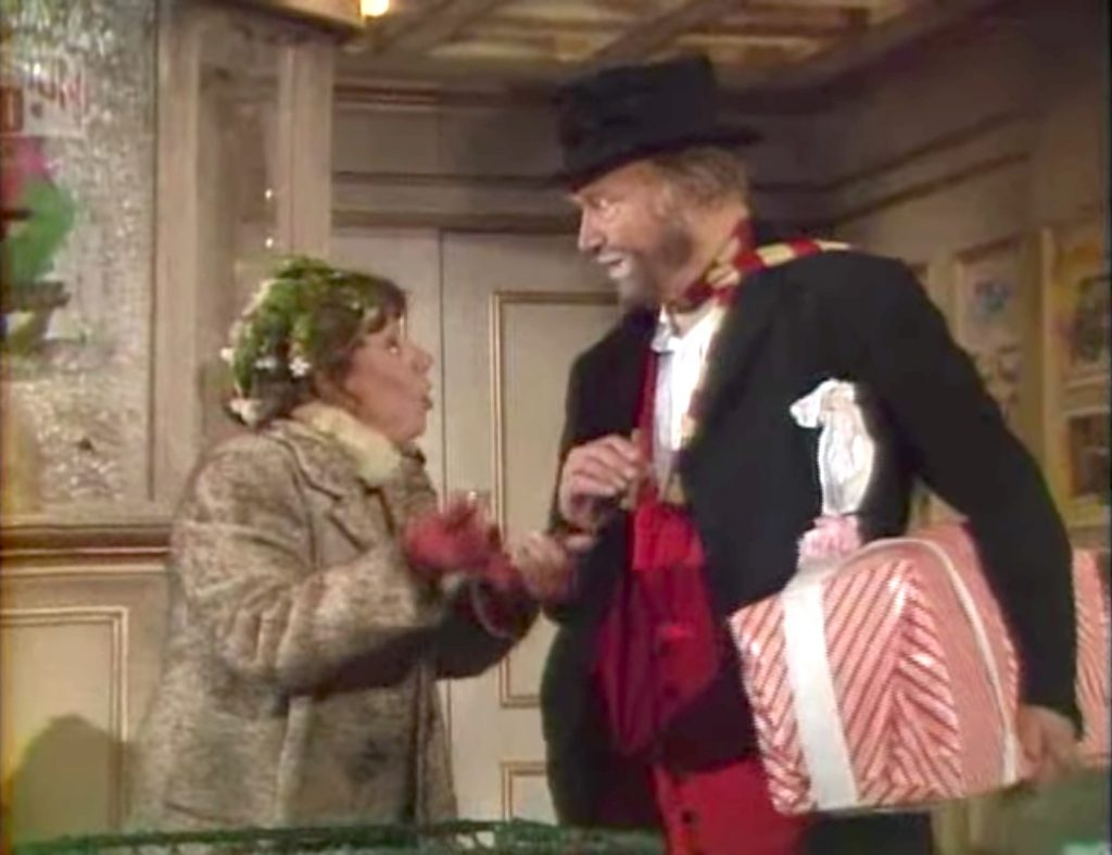 Imogene Coca as a bag lady chatting with Freddie the Freeloader in Red Skelton's Christmas Dinner