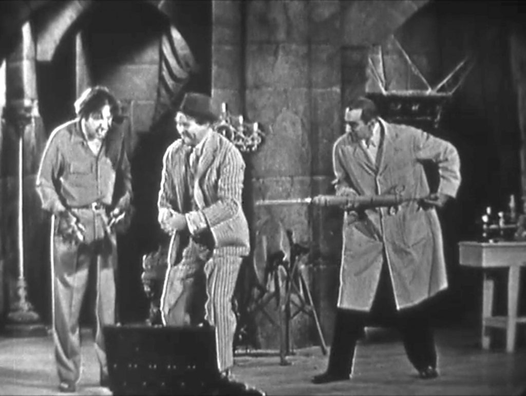 Bela Lugosi about to inject Clem Kadiddlehopper while Lon Chaney Jr. distracts … this won't hurt a bit!