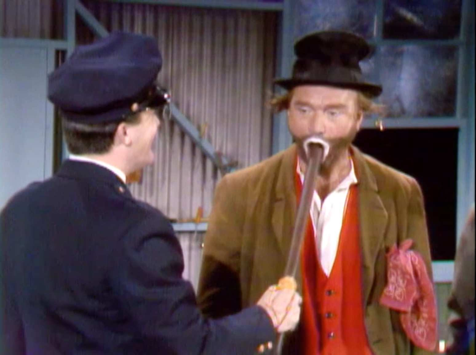 """Officer McGuire (Robert Vaughn) beating Freddie the Freeloader (Red Skelton) on the inside -- so the bruises don't show -- in """"Never on a Bum Day"""""""