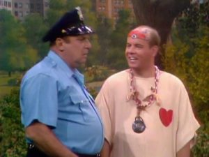"""Jackie Coogan (cop) and Tim Conway (hippie) in """"Hippie Days are Here Again"""""""