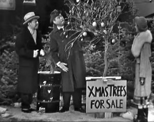 Mr. DeLeo at Clem Kadiddlehopper's Christmas tree lot, with Daisy June - as Clem tries to sell him an orange tree for Christmas!