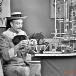 """Junior, the Mean Little Kid (Red Skelton) is using his chemistry set to make an exploding cigar for the doctor in """"Ten Little Fingers and Twelve Little Toes"""""""