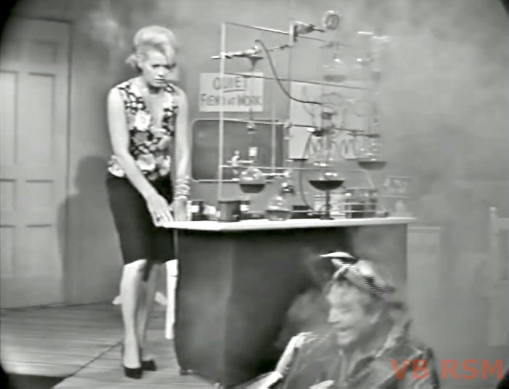 """Mrs. Cavendish (Janis Paige) checks on her little boy Junior (Red Skelton) after the explosion he caused in """"Ten Little Fingers and Twelve Little Toes"""""""
