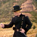 """Nathan Nobody (Robert Goulet) has trouble with his sword, acting as General Custer in """"The Fastest Cuspidor in the West"""""""