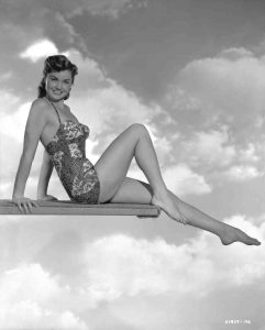 Esther Williams showing off a bathing suit in Neptune's Daughter