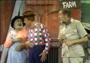 "Pa Kadiddlehopper (Jan Arvan), his idiot son Clem (Red Skelton), and Dr. Flygrabber (Vincent Price) at the Kadiddlehopper farm in ""Climb Upon My Knee, Dummy Boy"""
