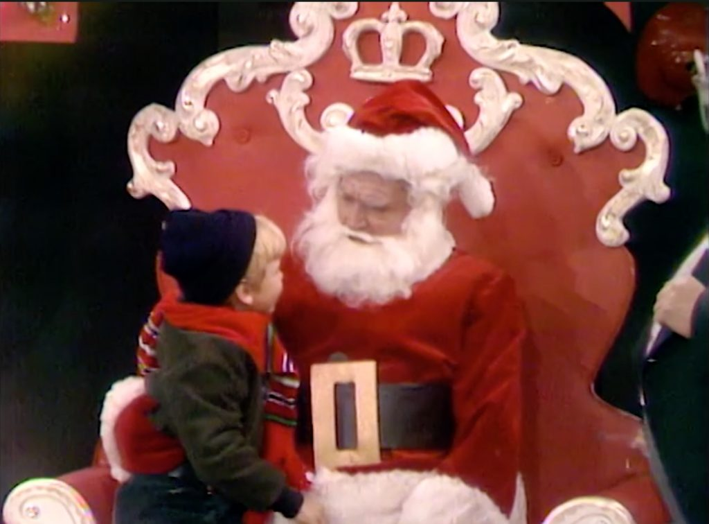 As Santa, Pops has kids sit on his lap - one bites him!  And he quits!