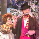 """Raggedy Ann tries to help Freddie the Freeloader with a candy cane in """"Freddie and the Yuletide Doll"""""""