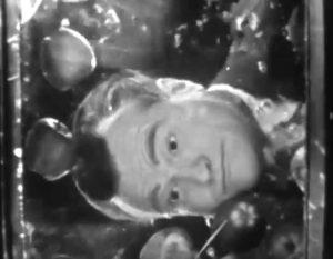 "Red Skelton demonstrates bobbing for apple in ""Halloween Show"""